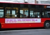 add your message to a picture showing a sign on a bus