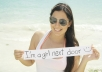 take SEXY picture holding your sign at the beach to promote your business or website