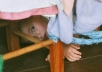 create a photo of a child under a table